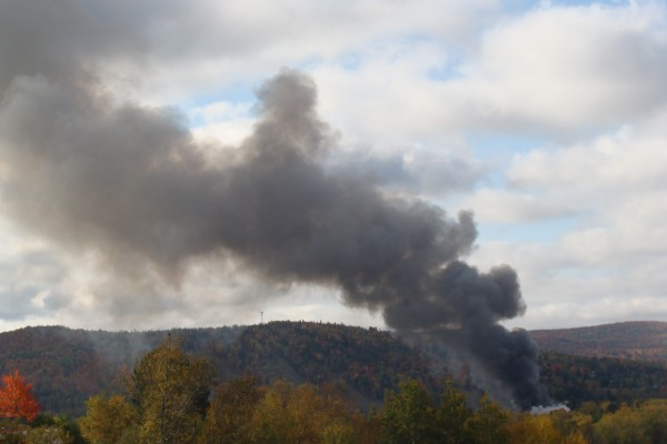 View from Station Hill cemetery of the fire at Valley Auto in Fort Kent on Wednesday, Oct. 3, 2012.