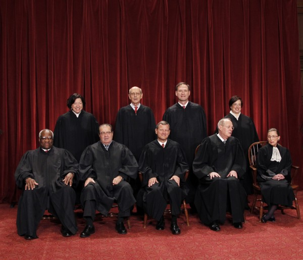 This Oct. 8, 2010 file photo shows the justices of the U.S. Supreme Court in a group portrait at the Supreme Court Building in Washington. Seated from left to right are: Associate Justice Clarence Thomas, Associate Justice Antonin Scalia, Chief Justice John G. Roberts, Associate Justice Anthony M. Kennedy, Associate Justice Ruth Bader Ginsburg. Standing, from left are: Associate Justice Sonia Sotomayor, Associate Justice Stephen Breyer, Associate Justice Samuel Alito Jr., and Associate Justice Elena Kagan.