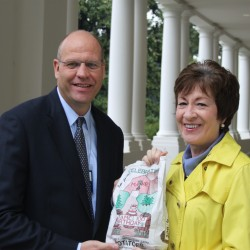 U.S. Sen. Susan Collins (right) presented the first potatoes harvested from The Aroostook Medical Center's Centennial Potato Plot in Presque Isle to the White House on on Tuesday, Oct. 2, 2012. Collins, a native of Caribou, presented the potatoes to Ed Pagano (left), deputy assistant to the president, outside the East Wing at the White House.