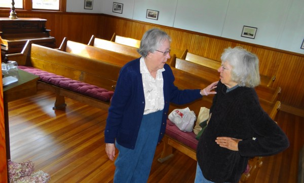 Joyce Fenner (left) and Ann Mullen discuss renovations to the chapel at Belfast's Grove Cemetery. The chapel will be open to the public 10 a.m. to 4 p.m. Friday, Oct 12, and cemetery tours will be offered at 10 a.m. and 1 p.m.