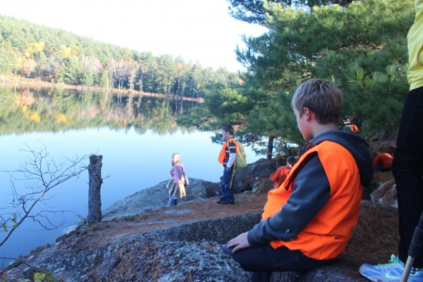 Nason Vassiliev (foreground), sixth-grader at William S. Cohen School in Bangor, pauses to look at the smooth surface of Snowshoe Pond in Eddington on Oct. 17, 2012, on his way to hike Woodchuck Hill with his school's hiking club. Also taking in the beautiful sight are eighth-grader Breanna Wilcox (left) and sixth-grader Mason Spencer.