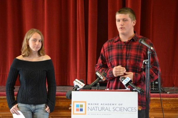 Nicholas Fothergill (right), a junior from Wiscasset, talks to a crowd at the Maine Academy of Natural Sciences at Good Will-Hinckley in Hinckley on Monday, Oct. 1, 2012. Fellow student, Olivia Broadrick, a senior from York, awaits her turn to speak.