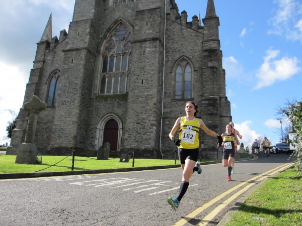Down East native Gladys Ganiel runs past St. Patrick's Church in Downpatrick, Northern Ireland, on her way to winning the Jimmy's 10K Road Race in March. The church is the site of St. Patrick's grave.