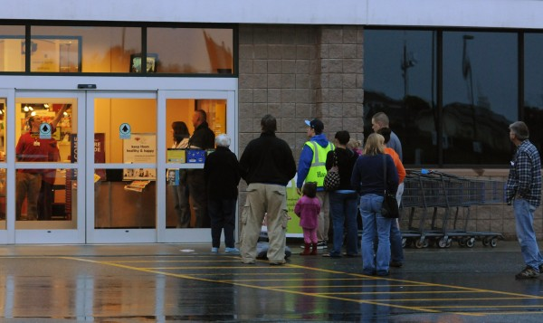 People wait in line for the Hannaford on Union Street in Bangor to reopen after police arrived to investigate reports of a pharmacy robbery at that location on Sunday, Sept. 30, 2012.