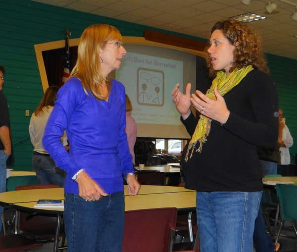 Jo-Ann Nealey (left), a second-grade teacher at the East Belfast School, talks with fellow second-grade teacher Ashley Reynolds, who teaches at the Capt. Albert Stevens School. The teachers attended a training session Friday, Oct. 5, 2012 at Searsport Elementary School.