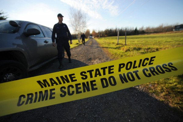 Lt. Jason Sattler of the Maine State Police stands guard at the end of Bobolink Drive off Mud Creek Road in Lamoine around 5 p.m. Tuesday, Oct. 23, 2012. Maine State Police continued to investigate the scene where two men were fatally shot early Tuesday morning. Police located and shot the suspect around 10 a.m. and the suspect was declared dead around 11:30 a.m. at Eastern Maine Medical Center in Bangor.