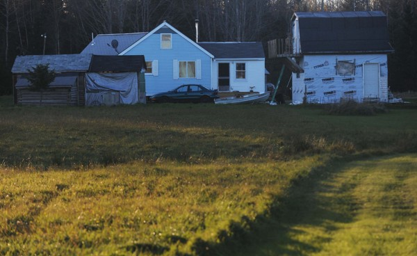 Police were combing an area around this home and other structures the end of Bobolink Drive off Mud Creek Road in Lamoine on Tuesday, Oct. 23, 2012. Maine State Police continued to investigate the scene there where two men were fatally shot early Tuesday morning. Police located and shot the suspect around 10 a.m. and the suspect was declared dead around 11:30 a.m. at Eastern Maine Medical Center in Bangor.