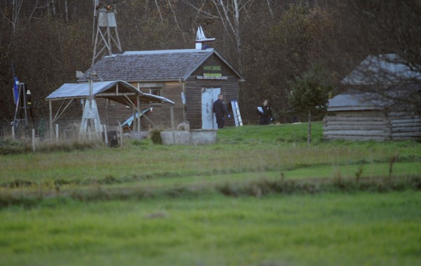Police were seen combing an area around this wood carving shop and several residences at the end of Bobolink Drive in Lamoine around 5 p.m. Tuesday, Oct. 23, 2012. Maine State Police continued to investigate the scene there where two men were fatally shot early Tuesday morning.