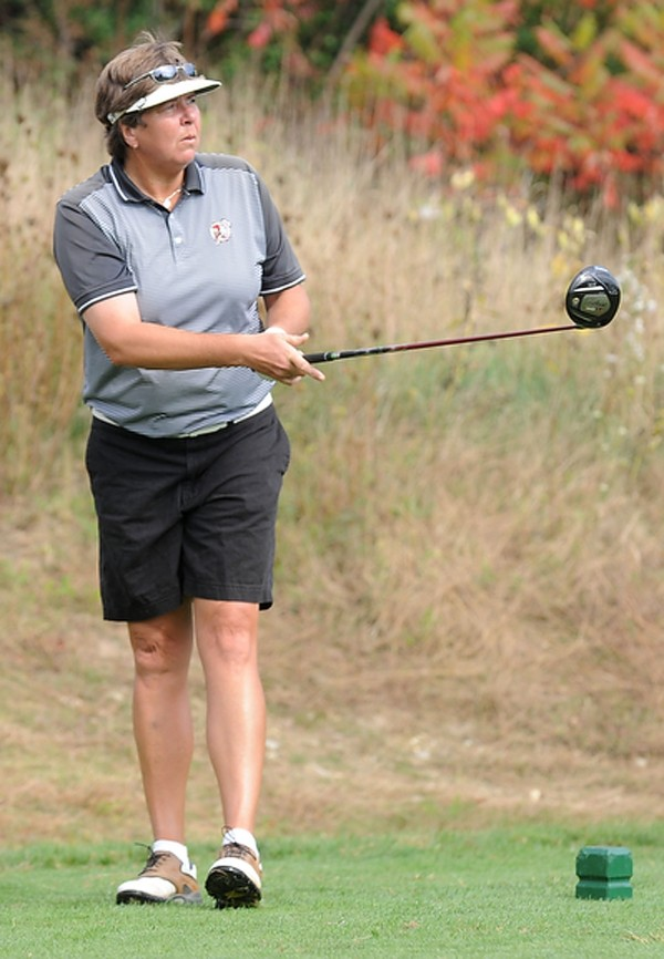 Liz Coffin watches her drive to the first green during a round of golf at Penobscot County Country Club on Wednesday, Oct. 3, 2012.