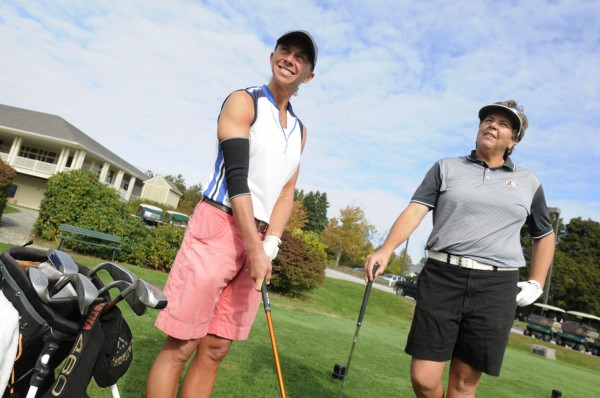 Jen Gavett (left) and Liz Coffin, catch up with each other during a round of golf at Penobscot County Country Club on Wednesday, Oct. 3, 2012.  Both University of Maine basketball players in the 1980s, they have turned their athleticism to golf, and both are excelling at it.