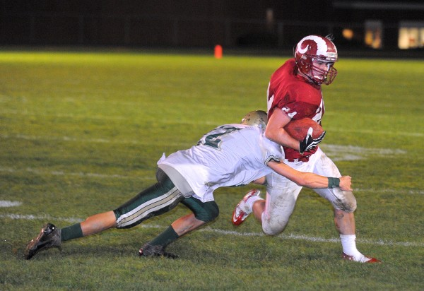 Bangor High School's Zeb Tuell (right) scrambles for more yardage as Oxford Hills High School's Ben Bowie tries to tackle him during the first quarter of the game in Bangor on Friday evening, Oct. 5, 2012.