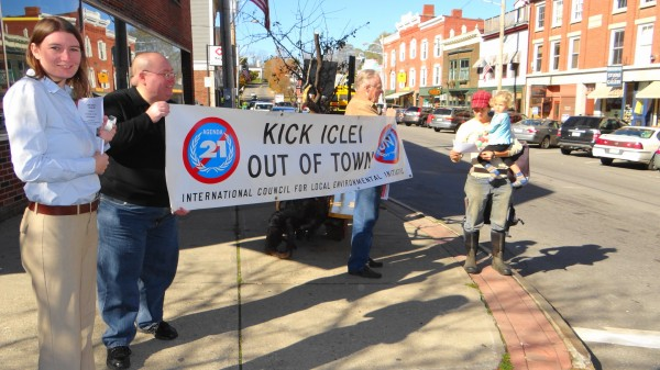 Protesters from the John Birch Society held banners in downtown Belfast Wednesday urging residents to push city government to sever ties with the International Council on Local Environmental Initiatives. The city has not been a member of ICLEI since 2010.