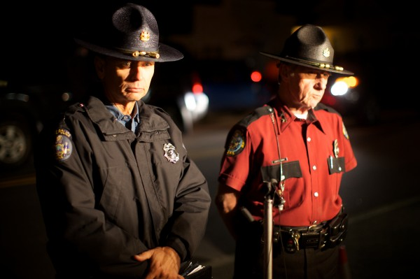 State Police Lt. Louis Nyitray (left) and State Fire Marshall Joe Thomas brief reporters outside the Goodwin's Mills Fire Department Tuesday night Oct. 16, 2012 about the capture of shooting suspect Donald Henson.