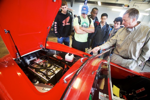 Tinkerer Wayne Krouth (right) of Standish shows off his electric-powered 1965 Shelby Cobra replica to a group of engineering students at Southern Maine Community College's National Alternative Fuel Vehicle Day on Friday, Oct. 19, 2012. From left are Chris Gerrish, Joe Parsons, Vassily Murangira, Minh Nguyen and Blake Laughlin.