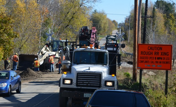 Crews from Newport public works and Pan Am Railways work to fix the railroad crossing on the west end of the Old Bangor Road in Newport on Wednesday, Oct. 17, 2012. Work on the crossing is expected to finish on Thursday, when work will start on the Spring Street crossing.