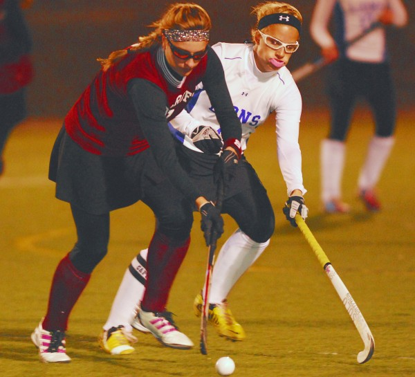 Foxcroft Academy's Julia Annis (left) tries to get by Belfast's Katrina Lapham (2) during first-half action of the Class B Eastern Maine championship game at Hampden Academy, Tuesday, Oct. 23, 2012. Belfast won 2-1.