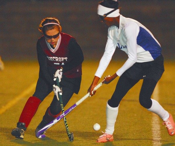 Foxcroft Academy's Abigail Simmons (21) battles for the ball with Belfast's Lexi Nelligan (8) during the Class B Eastern Maine championship at Hampden Academy, Tuesday Oct. 23 2012. Belfast won 2-1.