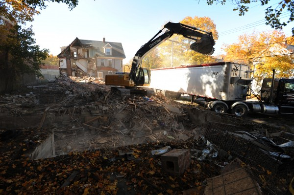 A crew from Gardner Construction of Hermon uses an excavator to demolish 16 Sanford Street in Bangor on Thursday, Oct. 25, 2012. Three other houses on that street were demolished Wednesday as part of a long-term expansion plan set forth by the Bangor Y.
