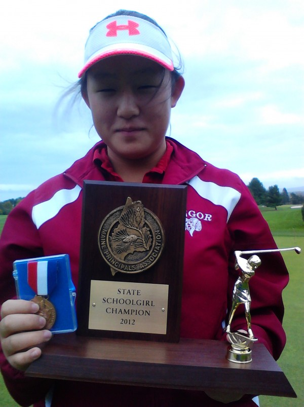 Alice Hwang displays her high school girls state golf title trophy and medal. She won Saturday, Oct. 13, 2012, at Natanis Golf Course in Vassalboro with an 84 on the Arrowhead Course.