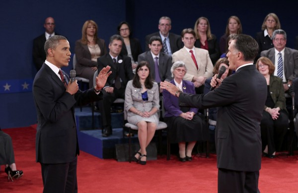 U.S. President Barack Obama (left) and Republican presidential nominee Mitt Romney speak directly to each other during the second U.S. presidential campaign debate in Hempstead, New York on Oct. 16, 2012.