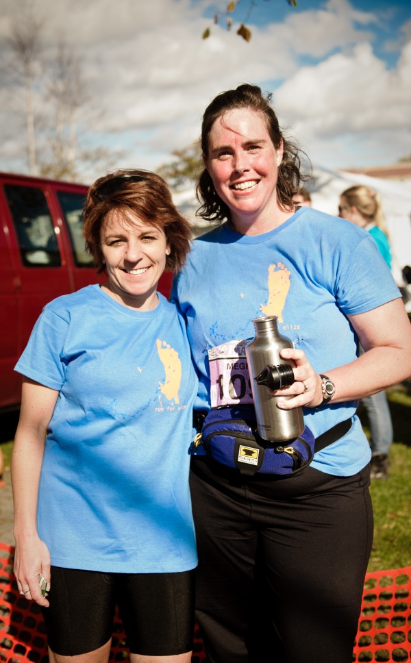 Cathleen Lutz, Phd., (left) stands with Mount Desert resident Meghann Harris after Harris completed the 2011 MDI Marathon to help raise funds for Rett Syndrome research. Harris' 6-year-old daughter Eliza Sprague has a rare form of the disease. This Sunday, Lutz , a scientist at Jackson Lab who is developing a mouse model to research Sprague's condition, plans to run in the annual race to continue the fundraising efforts.