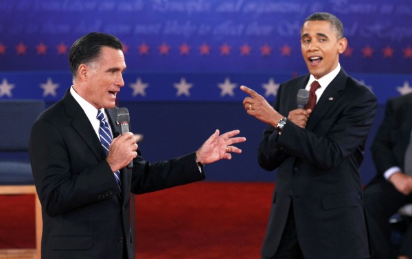 U.S. Republican presidential nominee Mitt Romney (left) and U.S. President Barack Obama answer a question at the same time during the second U.S. presidential campaign debate in Hempstead, New York on Oct. 16, 2012.