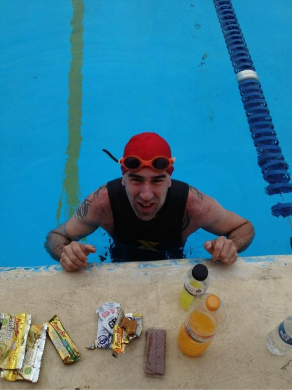 Turner native Kale Poland takes a quick nutrition and hydration break during his 24-mile swim as he competes in the 2012 decatriathlon in Mexico this week.