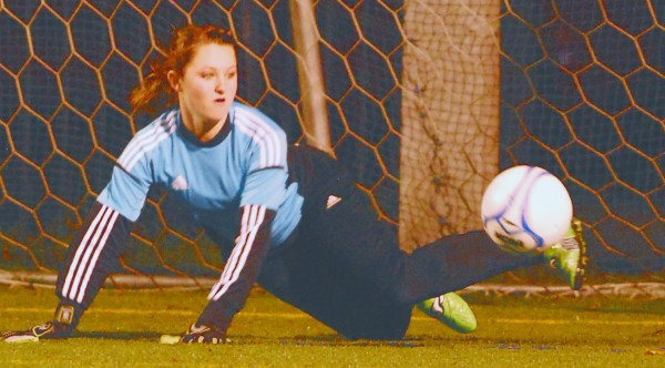 Hampden Academy goalie Sami Bowler makes a save early in the second half against Bangor during the Eastern Maine Class A final at Husson University in Bangor Wednesday night Oct. 31 2012. Bangor won 4-2.