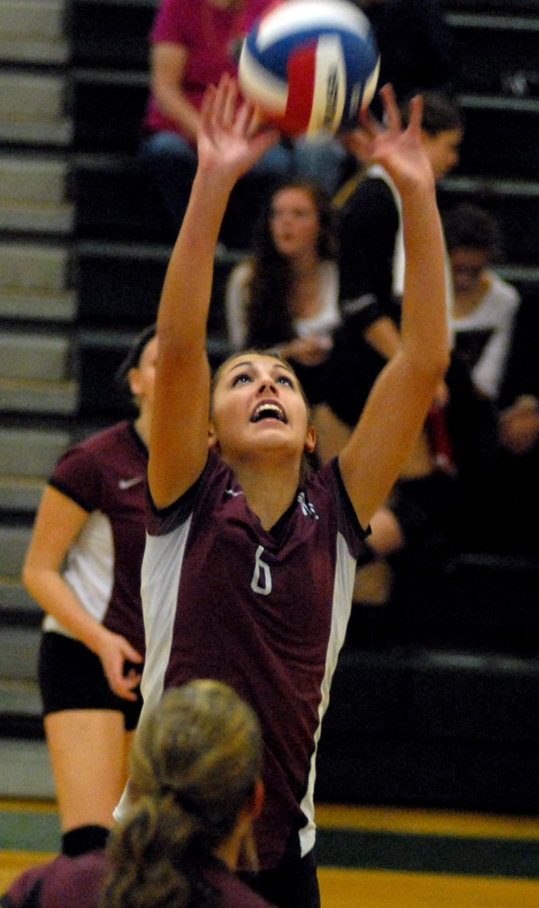Washington Academy's Kassidy Seeley sets the ball during the Class B state championship against Calais on Saturday night, Oct. 27, 2012 at Husson University.  Washington Academy won the Class B volleyball state crown.