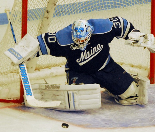 Maine's Dan Sullivan makes a save early in the second period against St. Lawrence at Alfond Arena in Orono Friday night, Oct. 19, 2012.