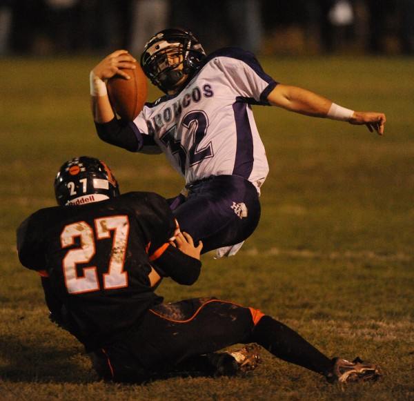 Brewer's Evan Lacey brings Hampden's Logan Steward down during 2nd quarter action at Brewer on Friday, Oct. 19, 2012.