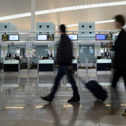 US raises compensation for fliers bumped from domestic flights