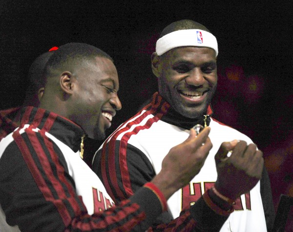 The Miami Heat's Dwyane Wade (left) and LeBron James celebrate after receiving championship rings at the American Airlines Arena in Miami, Fla., before the season-opener against the Boston Celtics on Tuesday, October 30, 2012