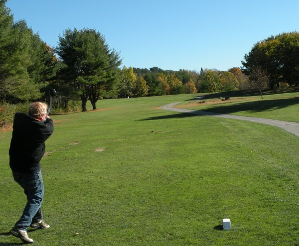 Dick Shaw of Hudson tees off on the 18th hole at Bangor Municipal Golf Course on Wednesday, Oct. 17, 2012. The removal of several trees on the right, marked by the stumps in the brown area above the white tee marker, has opened up the driving space available for golfers playing from the middle and forward tees. Two other holes, 14 and 15, have also had trees removed to create wider zones in which to hit tee shots.