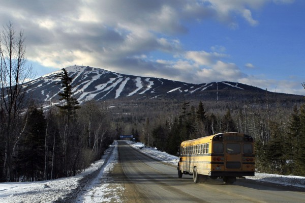 A bus takes Carrabassett Valley Academy skiers and snowboarders to Sugarloaf ski resort in February 2012.