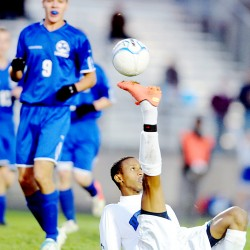 Abdullahi Shaleh boots the ball towards the net during the first half against Lawrence on Wednesday. Mohamed Ali picked up the feed and put the ball in the net for a 1-0 lead. Shaleh had the assist on the goal.