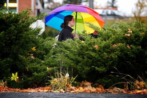 A woman walks on Marginal Way with an umbrella in Portland Monday, Oct. 29, 2012, as the wind and rain start ahead of Hurricane Sandy.