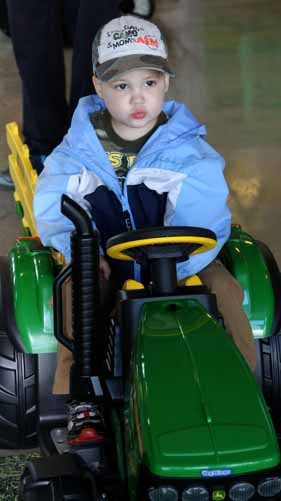 Stephen Drost, 2, of Washburn is pictured trying out a John Deere tractor from Theriault Equipment in Houlton. Drost was diagnosed with cancer in September. A fundraising dinner is slated for Oct. 20 at the Washburn District Elementary School.