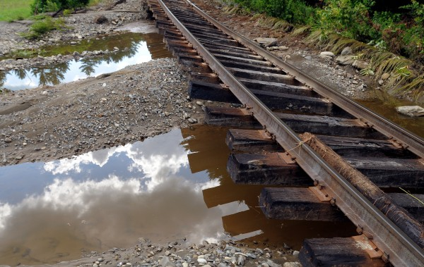 The flood washed away the gravel from several sections of the railroad tracks in Brownville. A storm dropped about eight inches of rain, causing extensive flooding and washouts in the area.