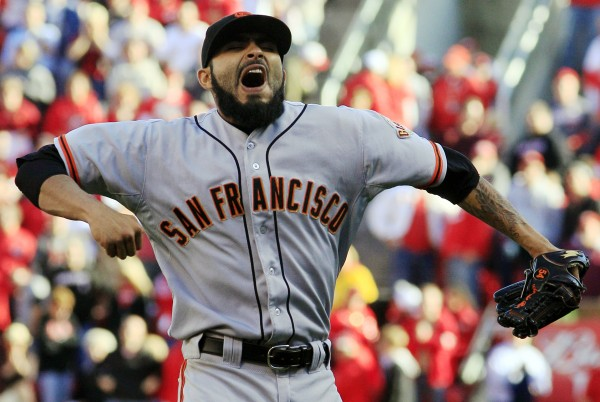 San Francisco Giants relief pitcher Sergio Romo celebrates after the Giants defeated the Cincinnati Reds 6-4 in Game 5 of the National League division baseball series, Thursday, Oct. 11, 2012, in Cincinnati. The Giants won the final three games, all in Cincinnati, and advanced to the NL championship series.