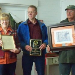 Photo: Greg and Lorna Young accepting the awards at the Shirley Bog Trail Busters Meeting on Thursday October 25, 2012 with President Charlie Baker