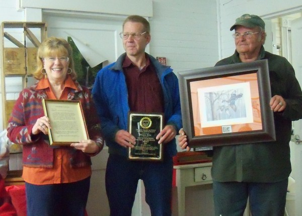 Photo: Greg and Lorna Young accepting the awards at the Shirley Bog