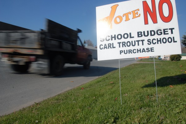 Signs like this one seen Friday on Fleming Street in Lincoln, are indications of some residents' discontent with a plan to revitalize Dr. Carl Troutt School in Mattawamkeag and with the leadership of RSU 67 Superintendent Denise Hamlin.