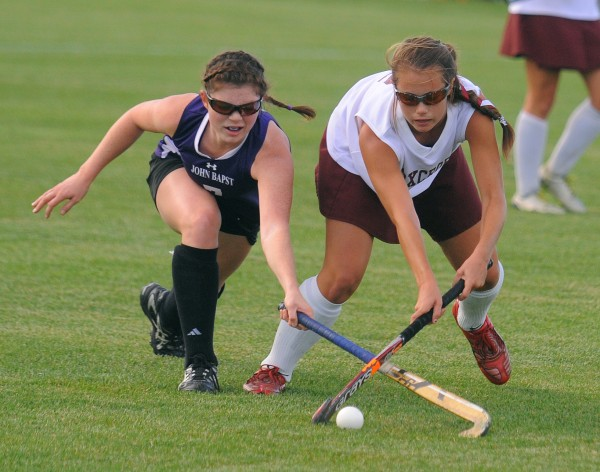 John Bapst Memorial High School's Elise Tilton (left) and Foxcroft Academy's Emily Higgins battle for the ball during a high school field hockey game in September. Tilton is one of four finalists for the Miss Maine field hockey award.