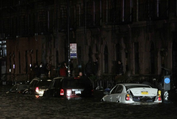 Flood waters brought on by Hurricane Sandy over run cars in New York's lower east side, Oct. 29.