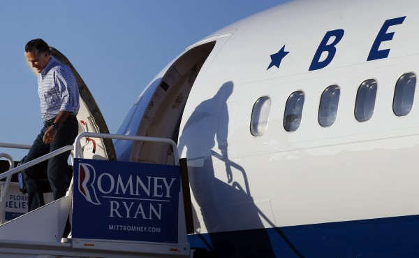 Republican presidential nominee Mitt Romney gets off his campaign plane in Tampa, Fla., Oct. 30.