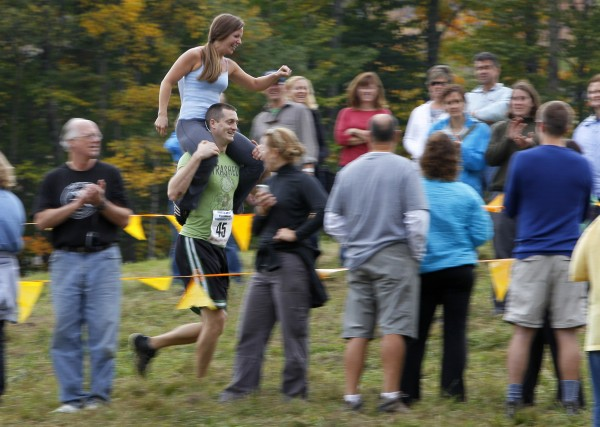 Michael Keefe, of Effingham, N.H., carries Jessica Keefe during the 2012 North American Wife Carrying Championship, Saturday, Oct. 6, 2012, at the Sunday River Ski Resort in Newry. Jessica was the only wife to ride right-side up. They finished 17th place out of about 50 couples.