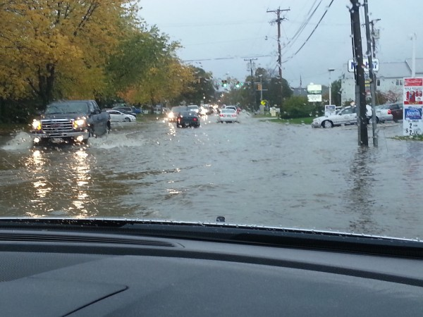 Drivers navigate through flooding on Stillwater Avenue near the Howard Street intersection in Bangor on Saturday, Oct. 20, 2012.