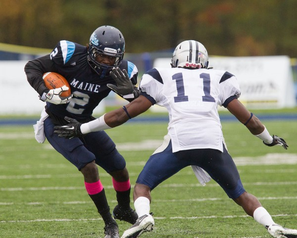 UMaine wide receiver Maurice McDonald (2) tries to get past UNH safety Tre Williams (11) during an 8-yard run in the first half of their game Saturday, Oct. 20, 2012.
