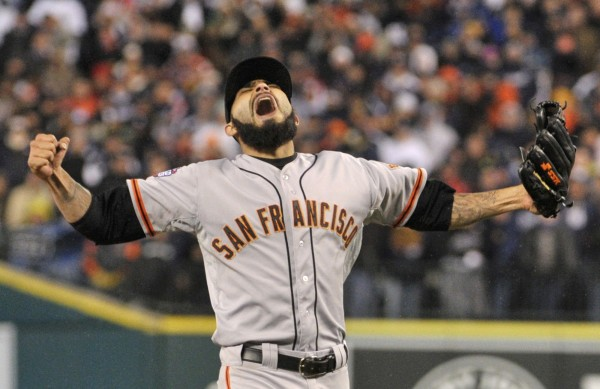 San Francisco Giants relief pitcher Sergio Romo celebrates after the Giants defeated the Detroit Tigers 4-3 in 10 innings in Game 4 to win the World Series baseball championship in Detroit Sunday night, October 28, 2012